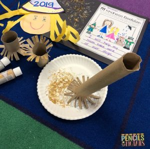 New Year's Eve Craft made with construction paper hair and a paper towel roll for preschool, kindergarten, and first grade students